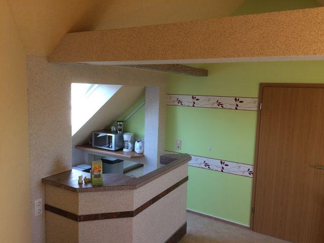 Offener Küchenbereich mit Theke