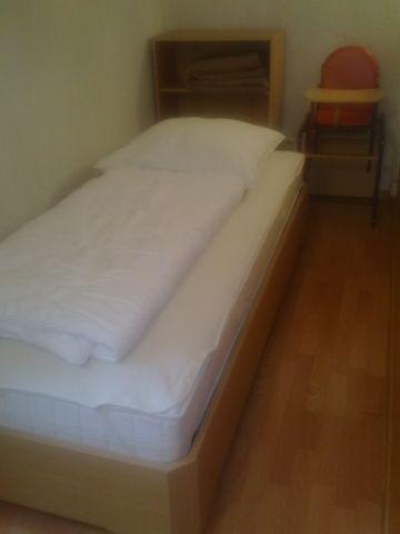 Bett auf Empore