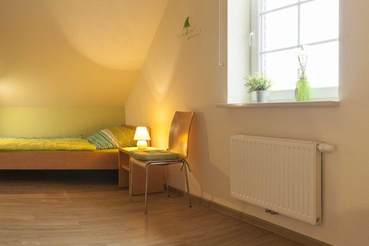 Schlafzimmer im Obergeschoss mit 2 Einzelbetten