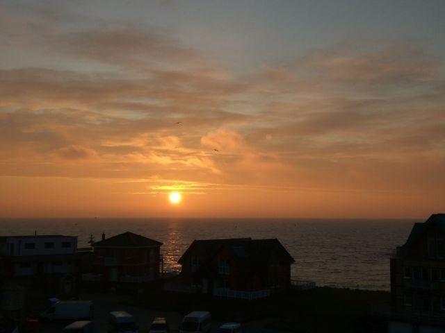 Sonnenaufgang auf der Dachterrasse mit Ostseeblick