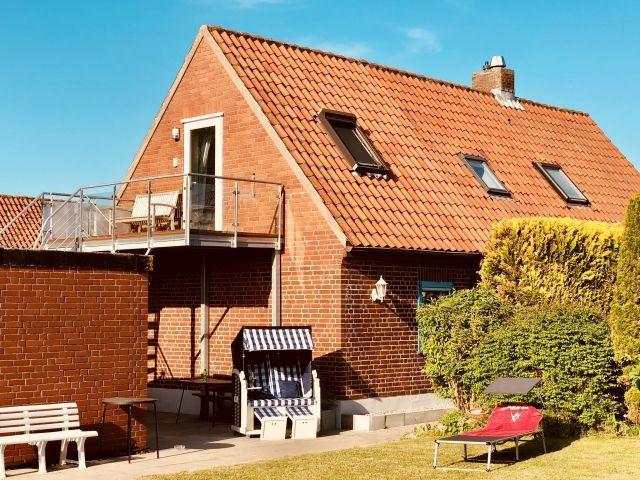 Balkonwohnung mit Meerblick und Garten