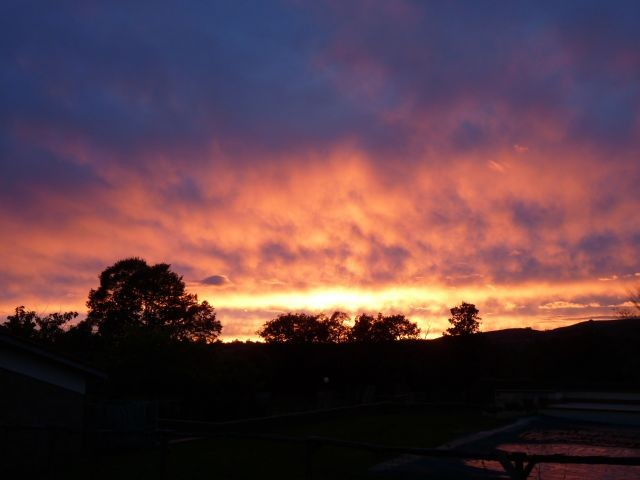 Ausblick vom Garten und Pool - Sonnenuntergang
