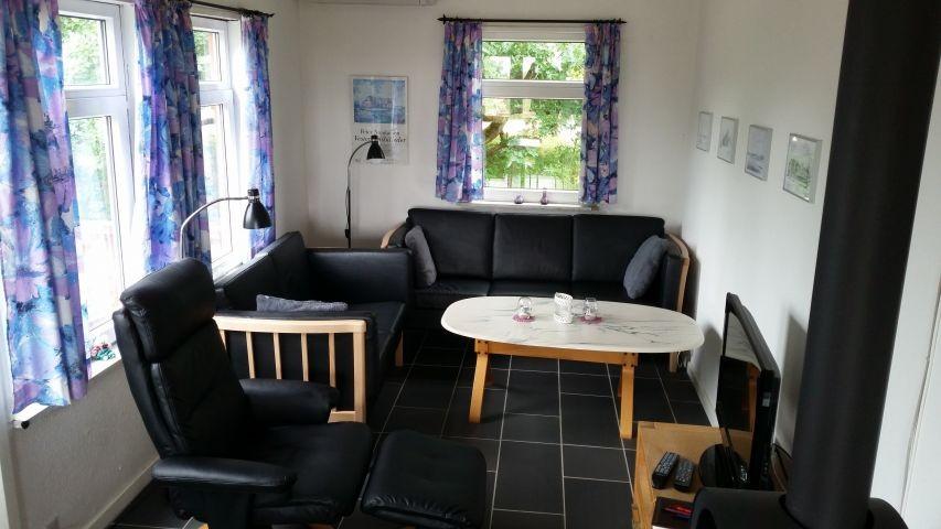 Wohnzimmer mit Holzofen - Fußbodenheizung