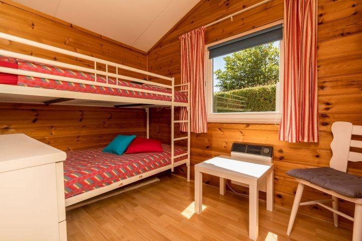 Schlafzimmer 3 mit Etagenbett und Kommode