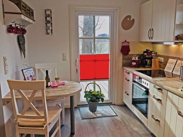 Die moderne Küche lädt zum gemeinsamen Kochen ein.