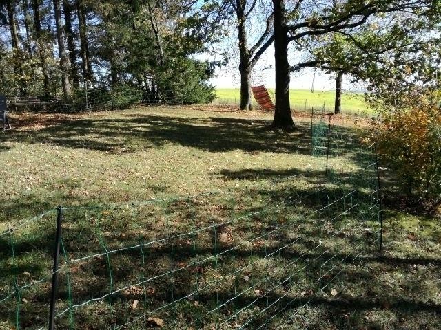 Garten mit mobilem Zaun