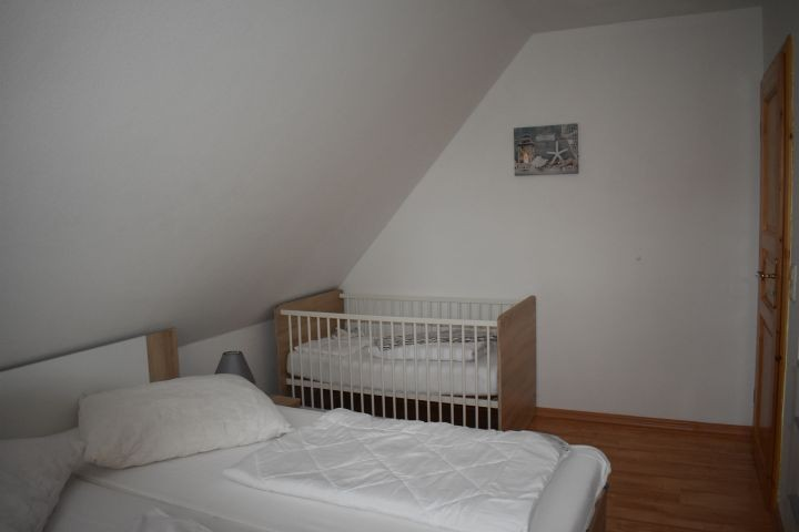 Schlafzimmer 3 mit Babybett