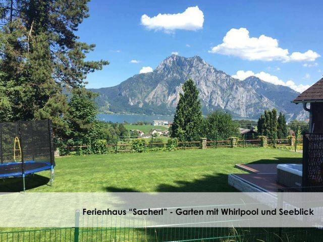 Panorama Seeblick im Garten mit Whirlpool, Griller und Gartenterrasse.