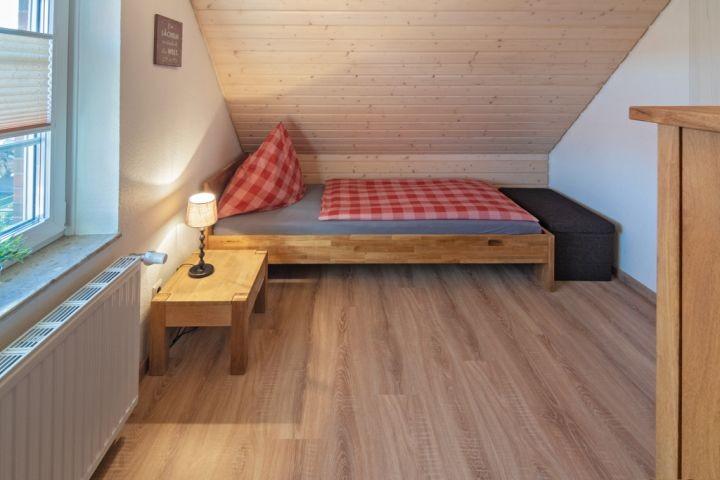 Schlafzimmer 1. OG mit Spielecke