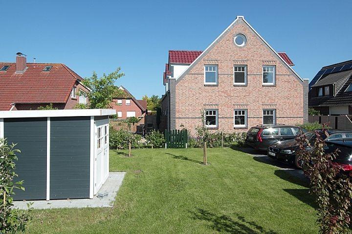 Rückseite des Hauses mit zusätzlichem Gemeinschaftsgarten