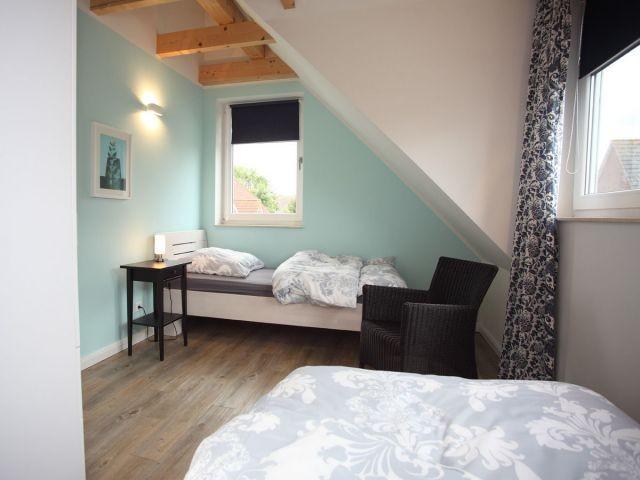 Zweites Schlafzimmer mit zwei gemütlichen Einzelbetten