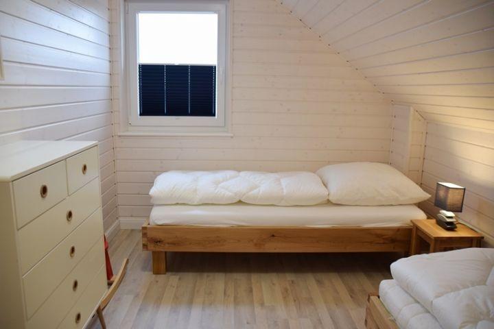 Einzelbettenschlafzimmer I Ferienhaus Sorgenfrei