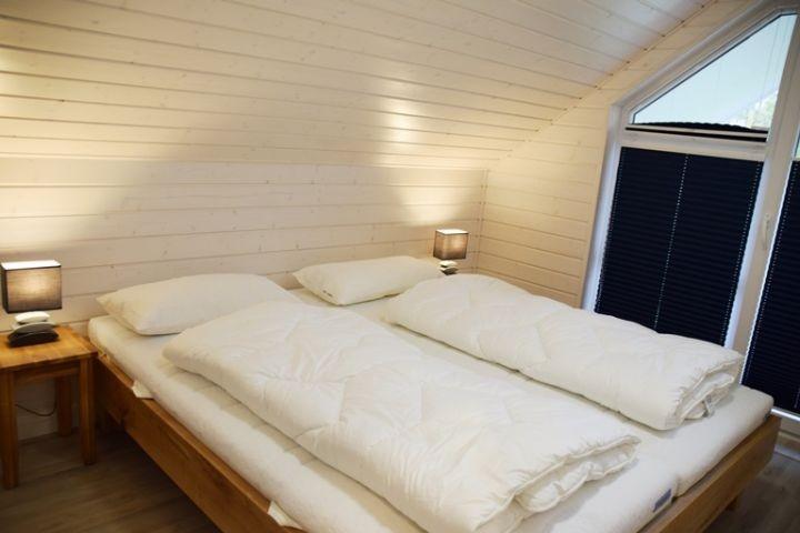 Doppelbettschlafzimmer I Ferienhaus Sorgenfrei