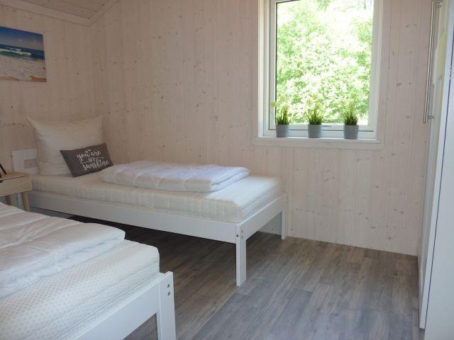 eines von 3 Schlafzimmern, dieses mit getrennten Betten