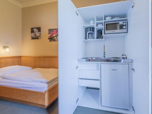Eigene kleine Küche im Apartment