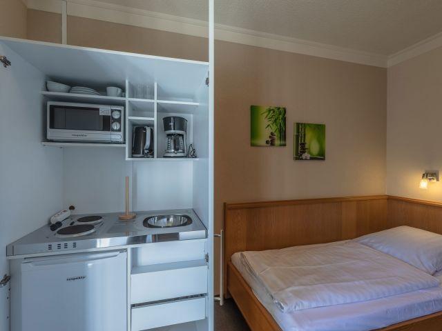 mit eigener Küche im Apartment
