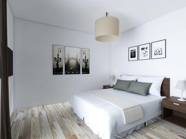 Freundliches Schlafzimmer mit Zugang zum Balkon