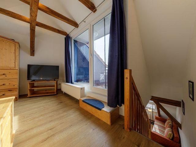 Schlafbereich mit Balkonzugang