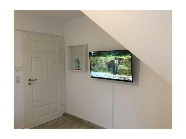 Elternschlafzimmer mit TV
