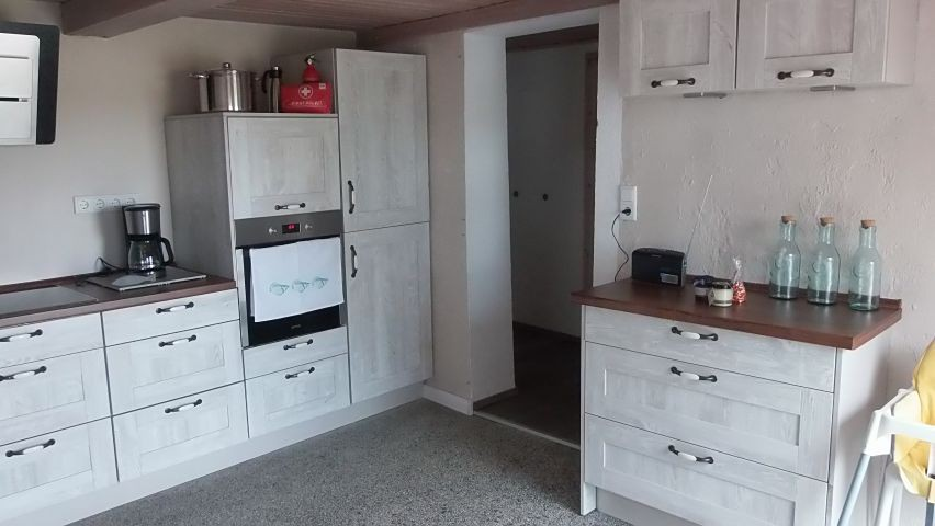 Küche mit Terrassenzugang