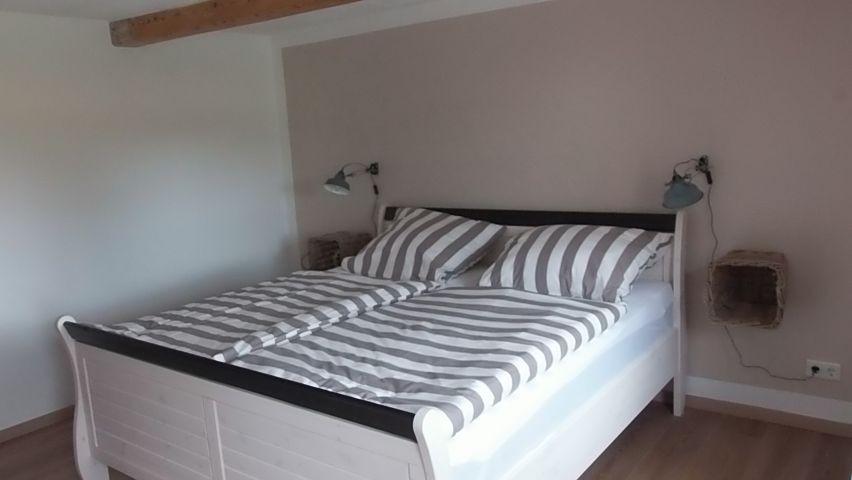 1. Schlafzimmer, Doppelbett und Terrassenzugang